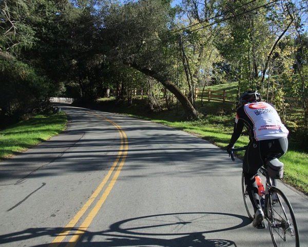 Kevin riding through Woodside on Mountain Home Road