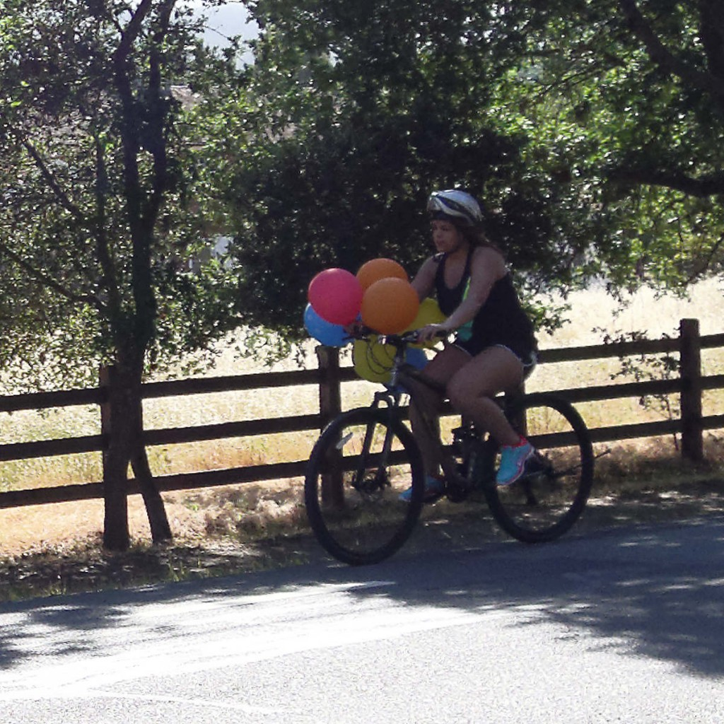 Don't know what's with the balloons, but might be a backward helmet too