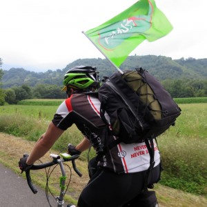 "Kevin flying the PMU flag on the way ""home"" to Lourdes after the stage"
