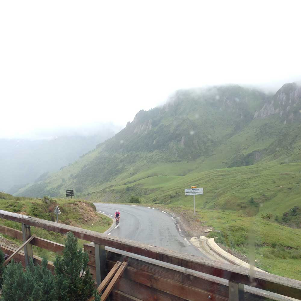 Watching riders come up the Col du Soulor from inside the cafe at the top