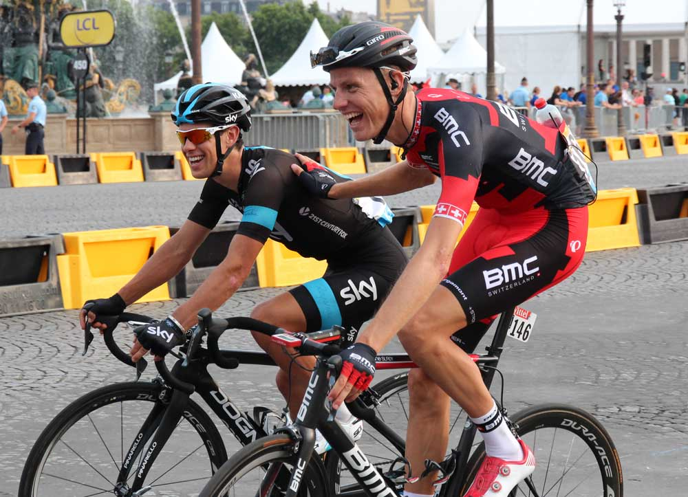 Sky's Porte and BMC's Schar enjoying a moment after finishing the TdF