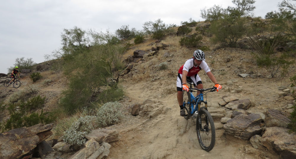 You can see Steve coming up fast on the guy rockin' it on the technical descent through the rocks. You're thinking yeah, that guy better move out of the way or Steve's going to run him over! Team Chain Reaction schooling the world! Yeah!