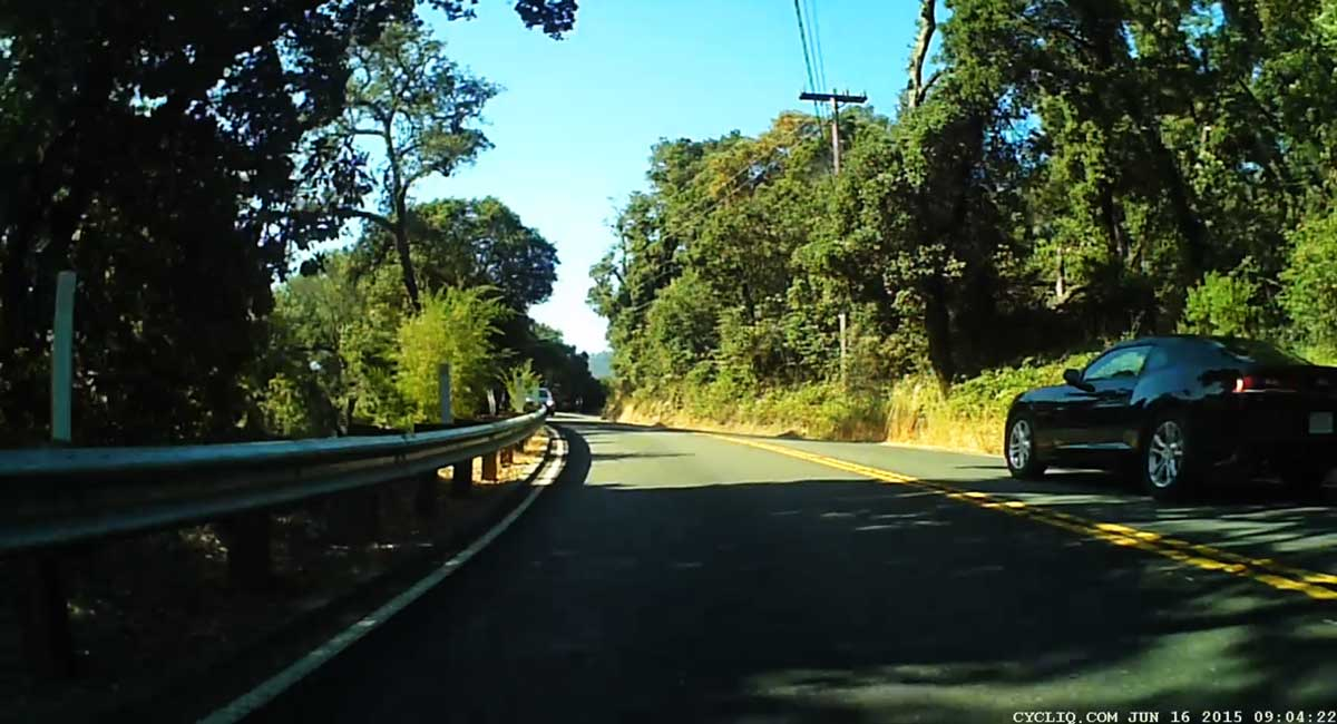 at 1:04, just two seconds later, a car passes in the opposite direction, way to the side of the road. This car, the car that passed me, and Kevin, all tried to share the same piece of road at the same time. The driver that clipped Kevin chose him as the path of least resistance.