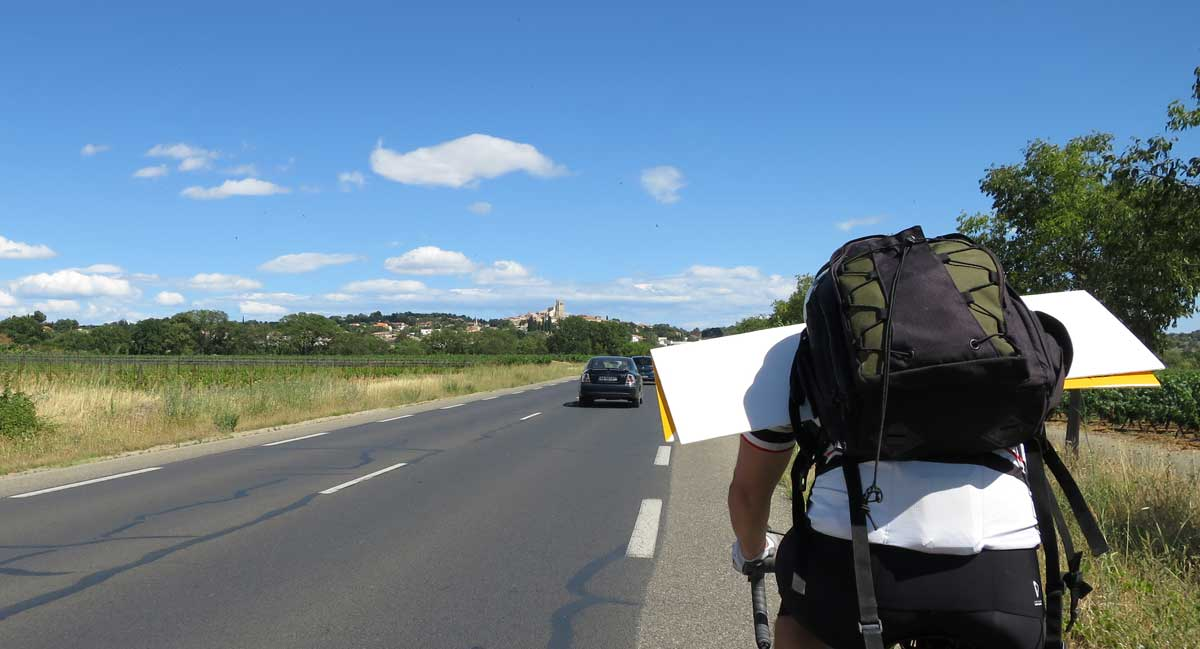 So how do you carry a very large sign on a bike? Like this! As long as you've got tailwinds, it works quite well. With a headwind, entirely different story. Fortunately we had tailwinds on the return, when Kevin carried the sign back.